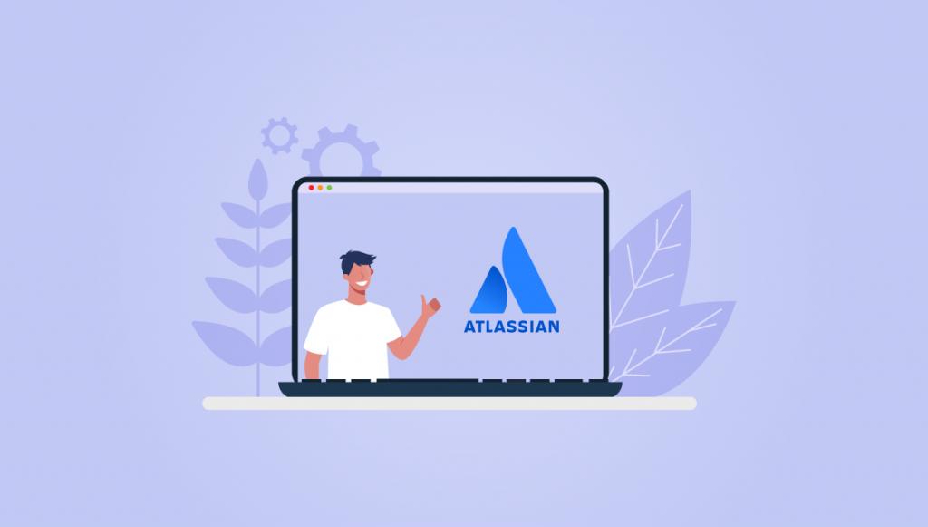 Person on laptop next to Atlassian logo